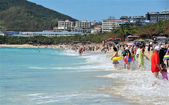 Tourists at Dadonghai beach in Sanya, Hainan province, in November  Photo: Rex
